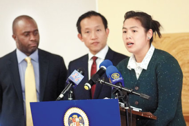 Annette Wong, CAA immigrant rights program manager, speaks at a Chinatown press conference about the Supreme Court case on deferred action. (photo credit: Ben Kwan, World Journal)